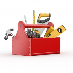 Toolbox with tools. Skrewdriver, hammer, handsaw and wrench